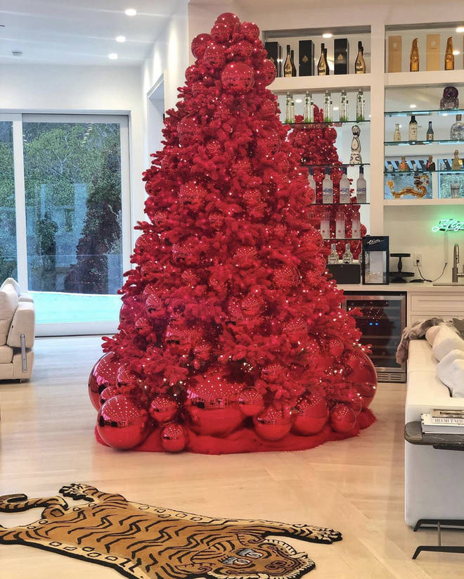 Alongside the red Christmas tree, Tyga's collection of alcoholic beverages sit on full display.