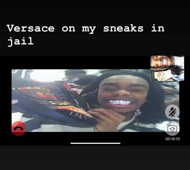YNW Melly shows off Versace sneakers in jail