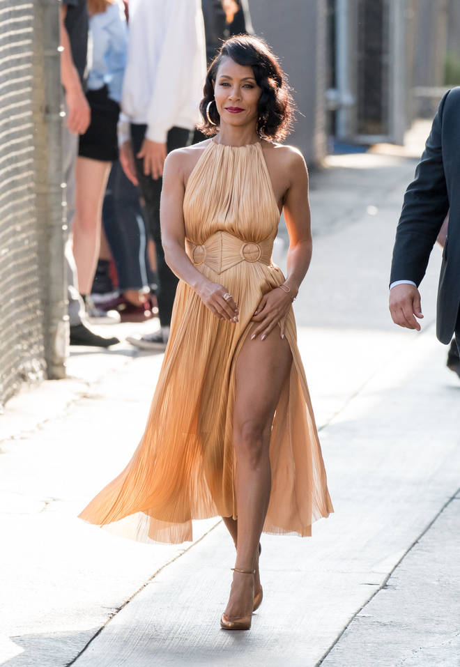 Jada Pinkett-Smith wears nude side split dress showing off her legs