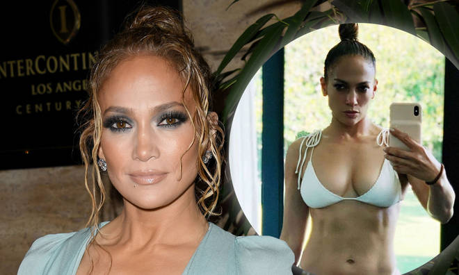 Jennifer Lopez displays her spectacular abs in a new bikini selfie.