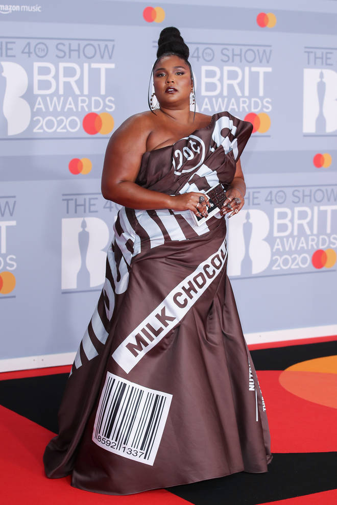 Lizzo arrived in an unusual gown inspired by a bar of chocolate.
