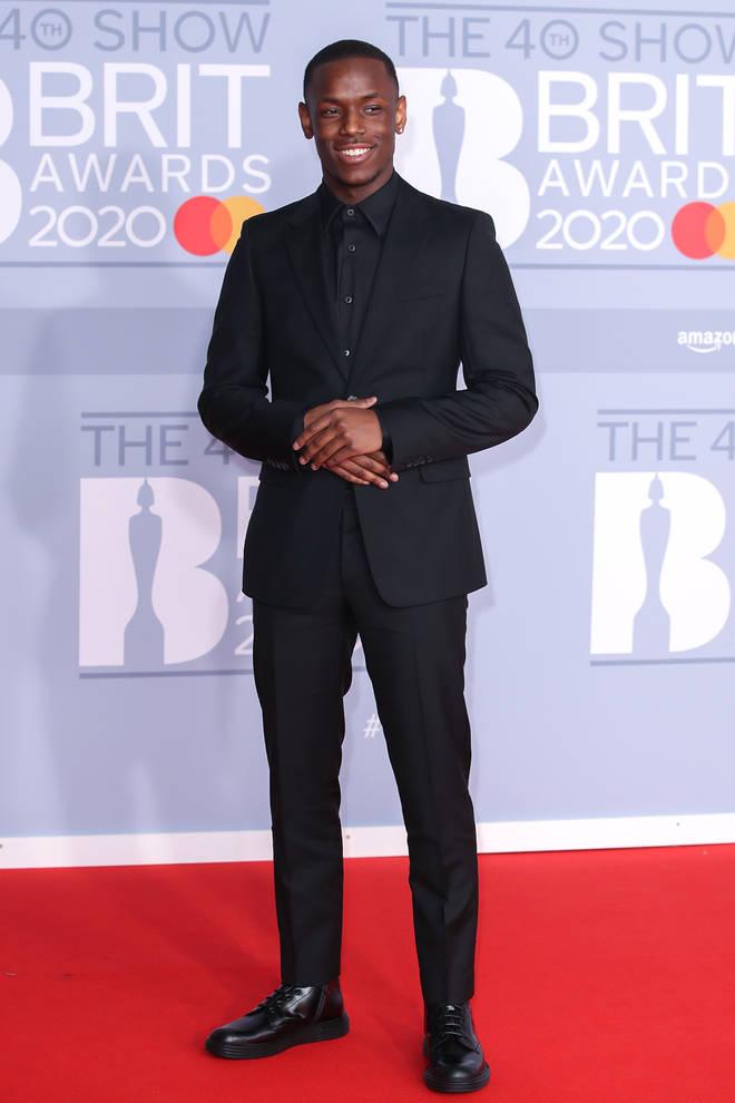 Top Boy's Michael Ward looked dapper in all-black.