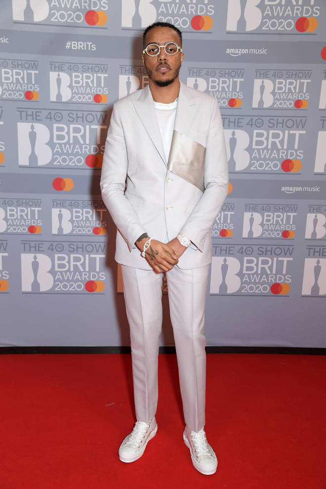 AJ Tracey wore a crisp white suit.