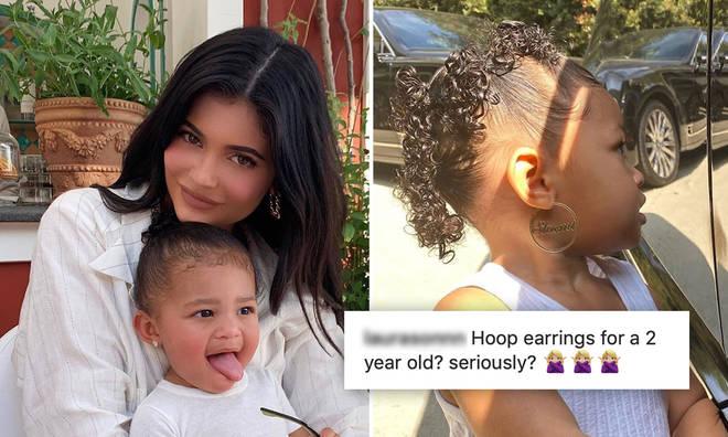Kylie Jenner has divided options after letting daughter Stormi, 2, wear huge hoop earrings.