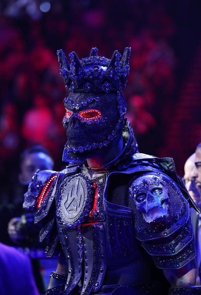 Deontay Wilder says his 40-pound costume wore down legs before his fight against Tyson.
