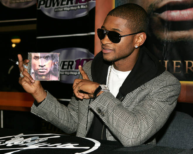 Usher Signs Copies Of His CD At Virgin Records in 2004