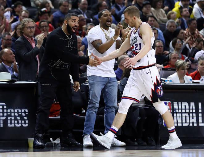 Drake debuts new earrings at Toronto Raptors game