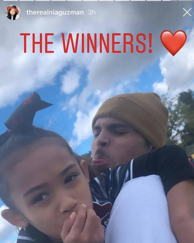 Nia Guzman shares photo of Chris Brown and Royalty