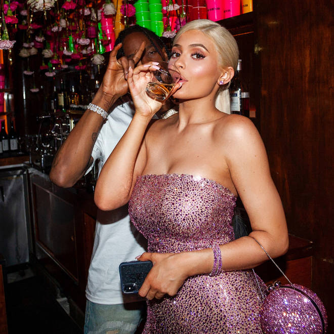 Kylie Jenner & Travis Scott drinking in a Las Vegas bar