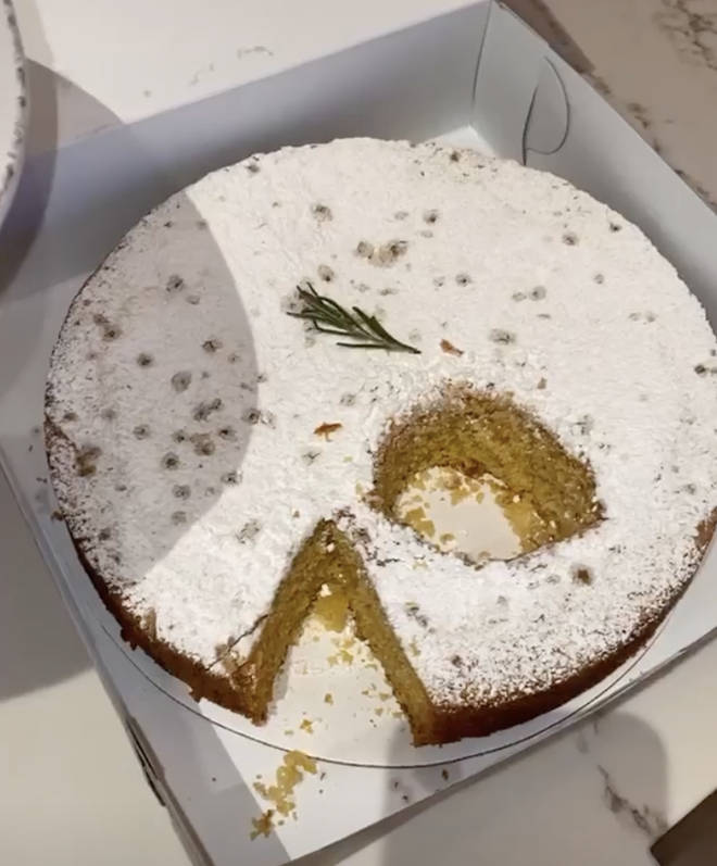 Kylie cut a circular piece from the middle of the cake.