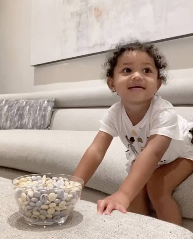 """Patience, patience!"" Stormi sings to herself in the video."