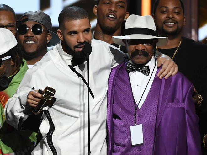 Drake's father Dennis Graham celebrates his Billboard Music Award win in 2017