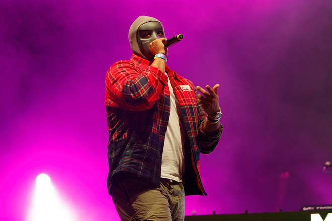 M Huncho keeps his identity hidden by wearing a mask during performances and in his music videos.
