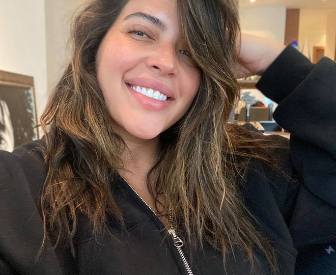 Denise Bidot celebrated her relationship with Lil Wayne on Instagram and clapped back at her haters.