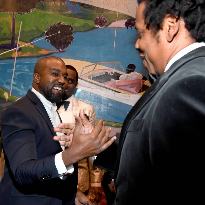 Kanye West and Jay-Z pictured together at Diddy's 50th birthday party.