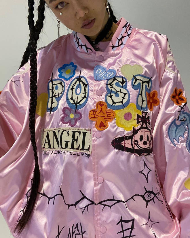 MLMA even customised her pink jacket to read 'Post' in wavy green writing on the front