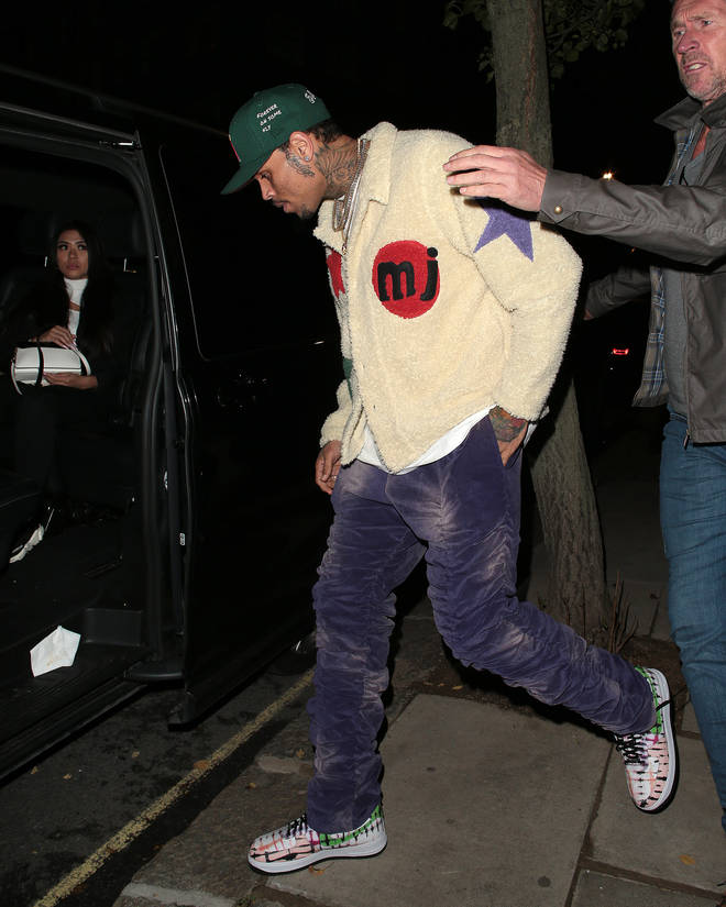 Chris Brown was seen getting into the vehicle with his girlfriend Gina