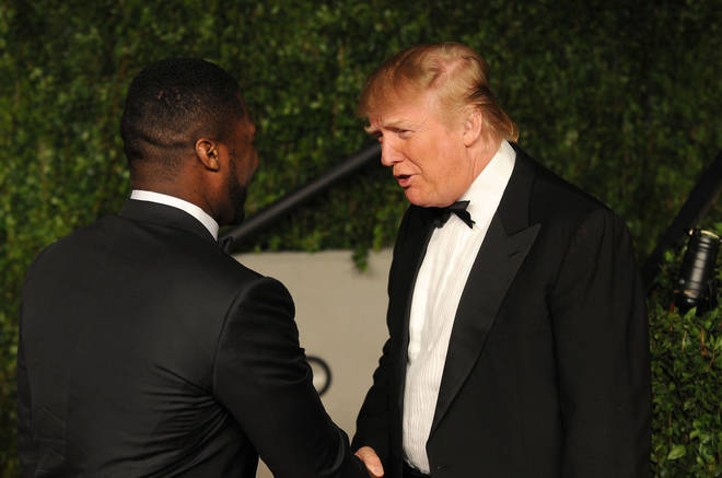 50 Cent and Donald Trump speaking at the 2011 Vanity Fair Oscar Party.