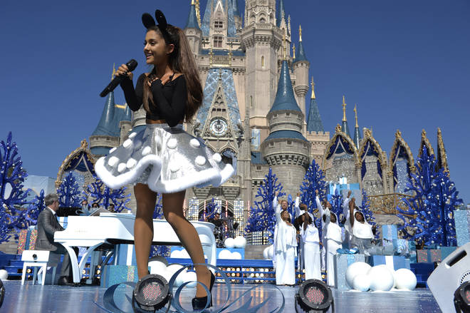 "Ariana Grande performs at ""Disney Parks Unforgettable Christmas Celebration"" in 2015"