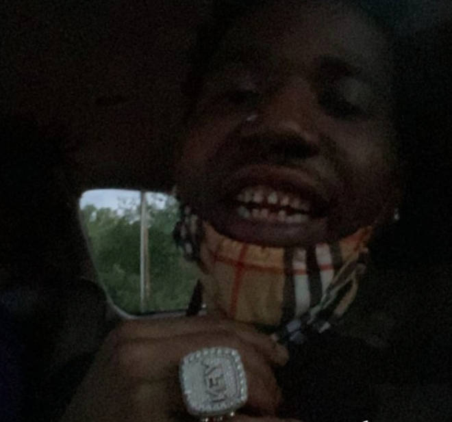 YFN Lucci shares a photo of his real teeth