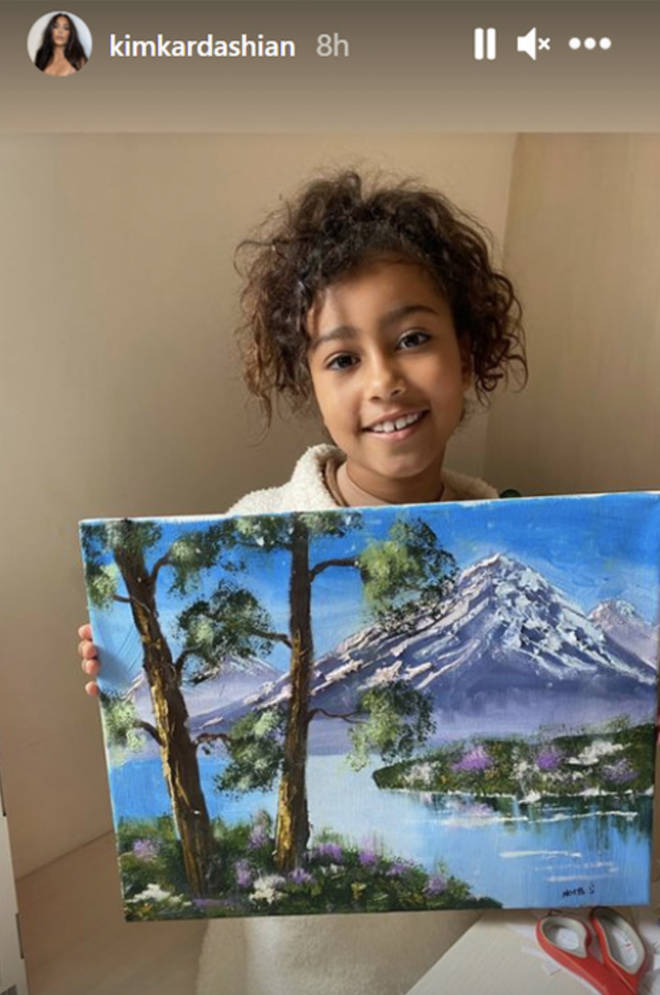 Kim Kardashian shares a photo of North West holding her oil painting