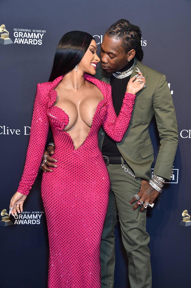 Cardi B flaunts her figure in a deep plunge dress alongside her husband Offset
