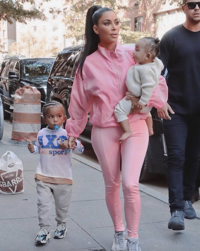 Kim Kardashian with Saint and Chicago.