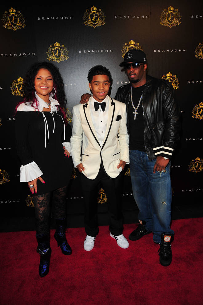 """Justin Dior Combs poses with his mother, Misa Hylton-Brim and  his father, Sean """"Diddy"""" Combs."""
