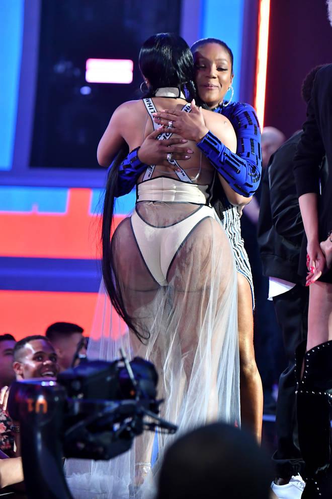 Nicki Minaj hugs Tiffany Haddish at the 2018 MTV VMA's while accepting her award
