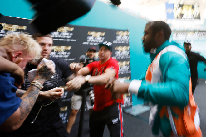 Jake Paul and Floyd Mayweather get into a heated scuffle at the Hard Rock Stadium.