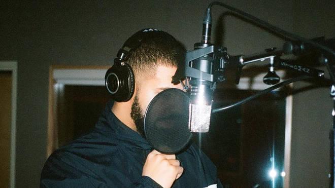 Drake wearing headphones
