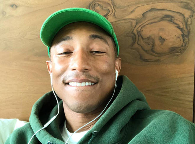 Pharrell Williams Listening To Music On Headphones
