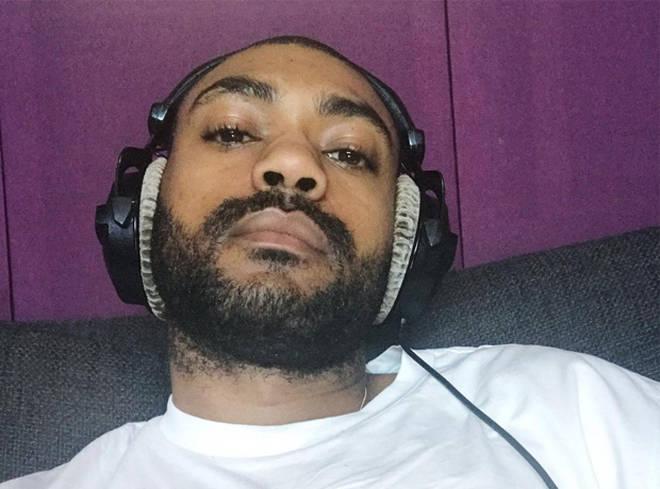 Kano Listening To Music On Headphones
