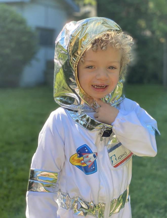 Adonis poses in his spacesuit.