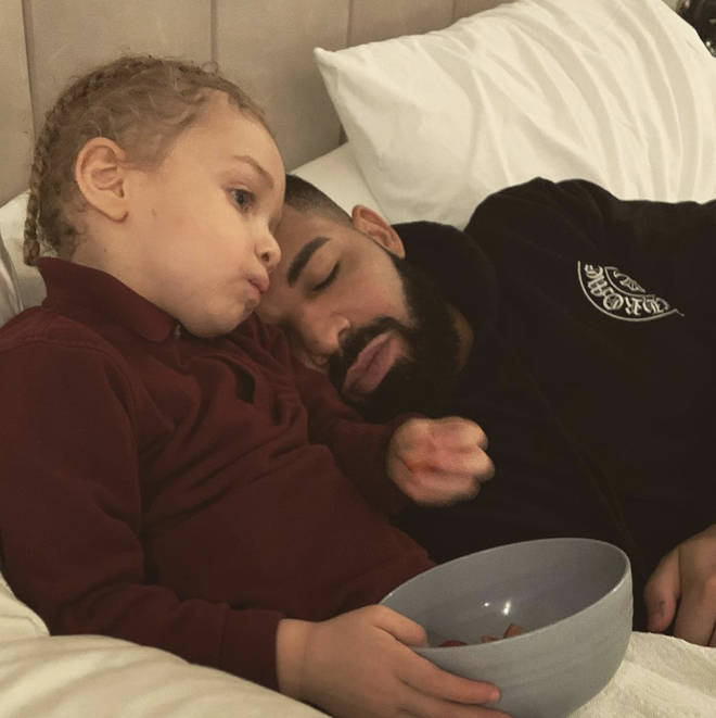 Drake shares a photo of him snuggled up in bed with his son Adonis.