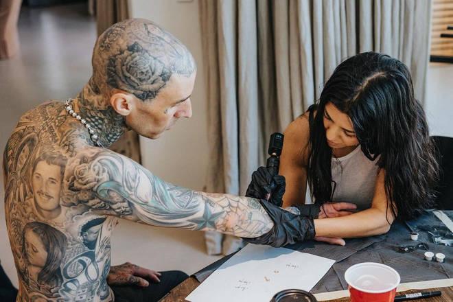 """I tattoo,"" Kourtney wrote on Instagram alongside snaps of her tattooing Barker."