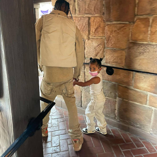 Travis and Stormi wore matching beige outfits.