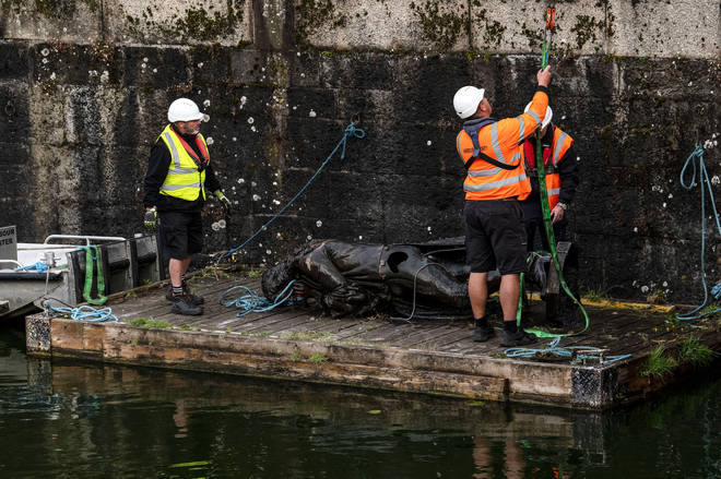 The statue of slave trader Edward Colston is retrieved from Bristol Harbour by a salvage team on June 11, 2020 in Bristol, England.