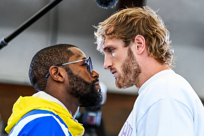 Floyd Mayweather and Logan Paul face-off during the media availability ahead of their June 6 exhibition boxing match