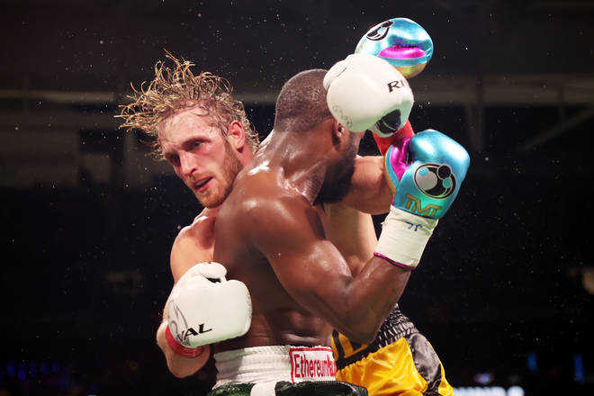 Floyd Mayweather exchanges blows with Logan Paul during their exhibition boxing match at Hard Rock Stadium on June 06, 2021