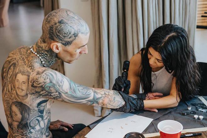 Kourtney left her mark on boyfriend Travis by giving him a romantic tattoo.