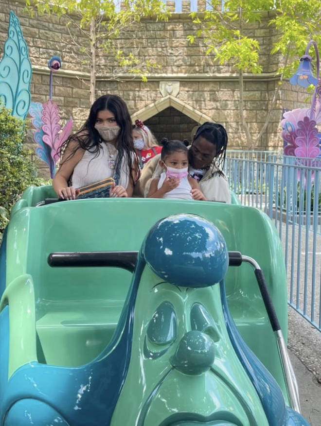Kylie Jenner shares photo of herself, Travis Scott and their daughter Stormi, on a ride at Disneyland.