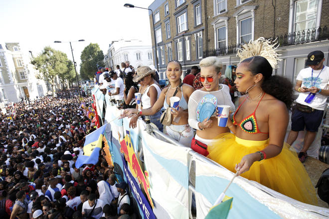 Courtney Rumbold (2ndR) and Leigh-Anne Pinnock attend the Red Bull Music x Mangrove truck at Notting Hill Carnival 2019.