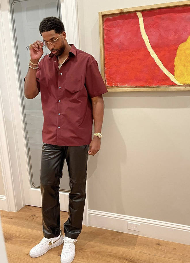 Tristan Thompson rocks a Burgundy shirt while sporting black leather trousers for Chubbs' birthday bash.