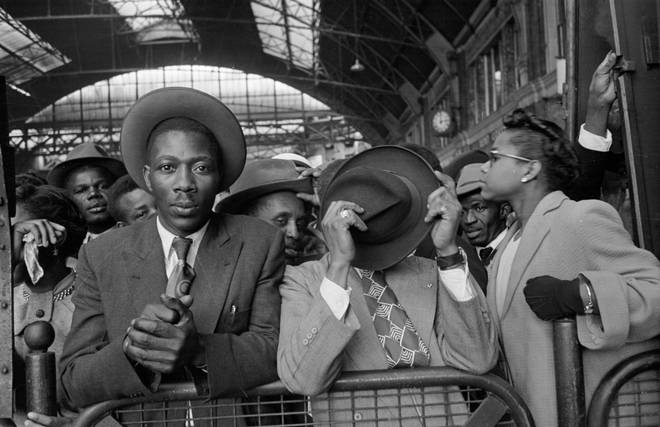 West Indian immigrants arrive at Victoria Station, London, after their journey from Southampton Docks in 1956.