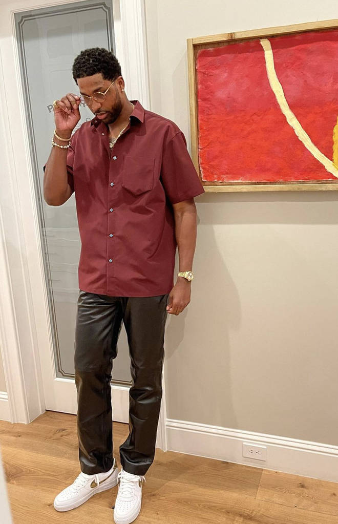 Tristan Thompson wears shirt and leather trousers to Bel-Air house party.