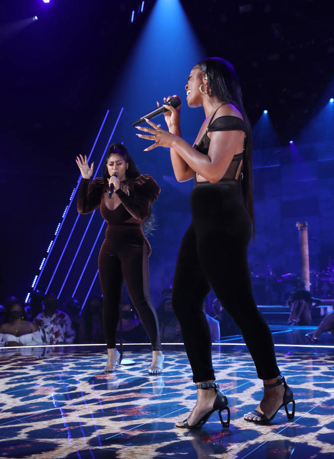 Jazmine Sullivan and Ari Lennox perform onstage at the BET Awards 2021 at Microsoft Theater on June 27, 2021 in Los Angeles, California.