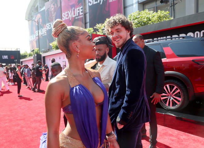 Saweetie and Jack Harlow interact on the red carpet at the BET Awards 2021.