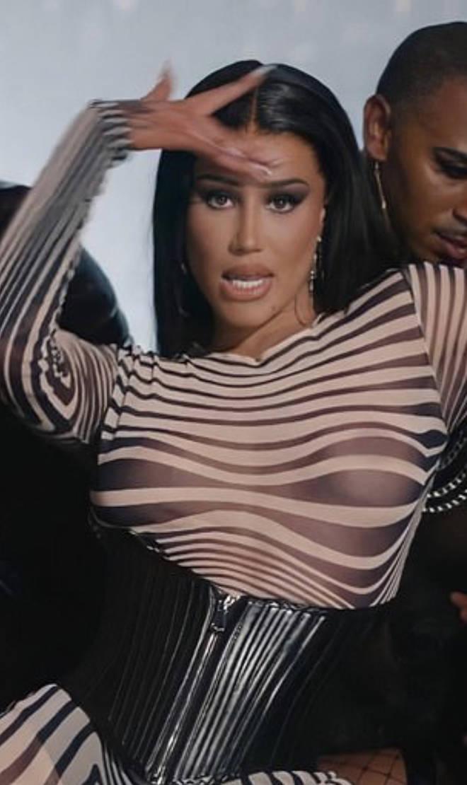 "An Iggy Azalea screenshot from her music video circulates online for ""blackfishing"" claims."