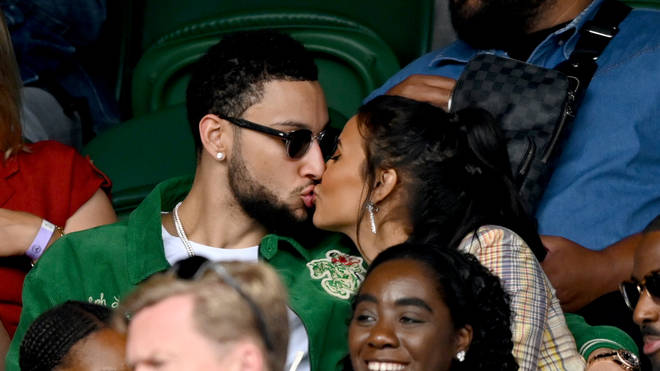 Ben Simmons and Maya Jama share a kiss at the Wimbledon Championships Tennis Tournament at All England Lawn Tennis and Croquet Club on July 05, 2021 in London, England.